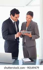 Young business partner looking at tablet together
