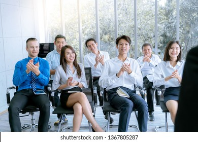 Young business people clap for lecture during presented marketing work project  in meeting room office