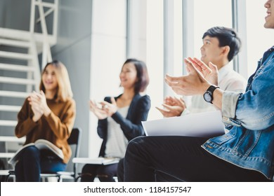 Young business people clapping hands during meeting in office for their success in business work