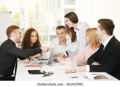 Young business people discussing a new project in a conference room