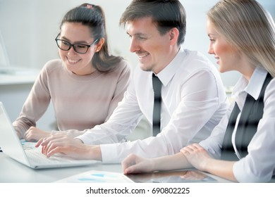 Young business people discussing a new project at a meeting in the office