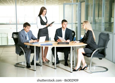 Young business people discussing a new project