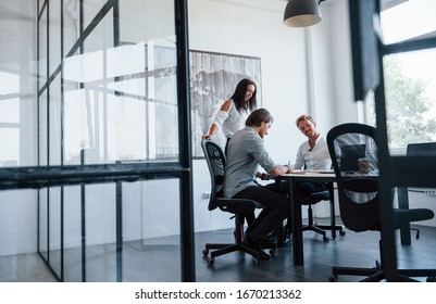 Young business people in formal clothes working in the office.