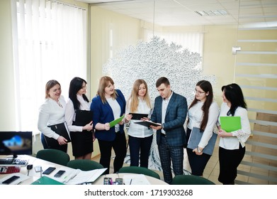 Young business people group of bank workers with clipboards have meeting and working in modern office.