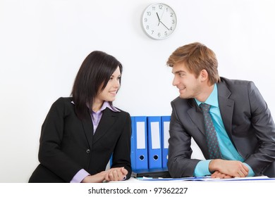 young business people happy smile talking, businessmen and women sitting at desk office discussing during working day, businesspeople work