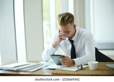 Young business people holding tablet working hard in office. Businessman worry about job project. He is thinking of new idea.
