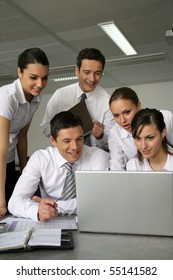 Young business people meeting in front of a laptop computer