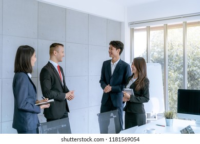 Young business people are presented marketing work project to the customer in meeting room office