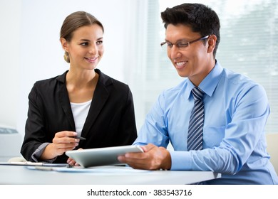 Young business people working in an office