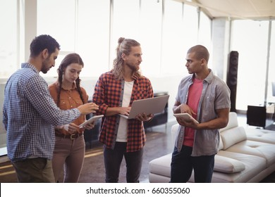 Young business people working together while standing at creative office