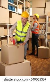 Young business people working at warehouse