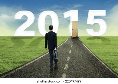 Young business person walking towards the future to success in 2015