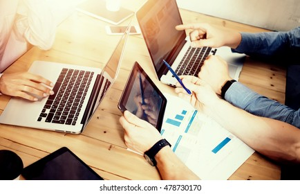 Young Business Team Brainstorming Meeting Room Process.Coworkers Startup Marketing Online Project.Creative People Making Great Work Decisions Wood Table.Tablet Laptop Diagram Screen.Blurred Background