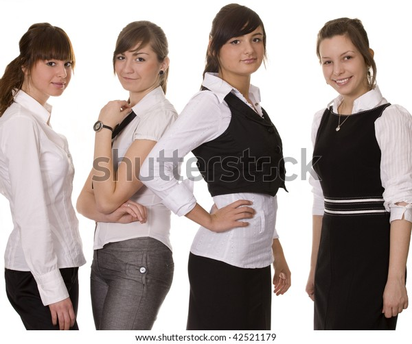 Young business team of four professional women. White background