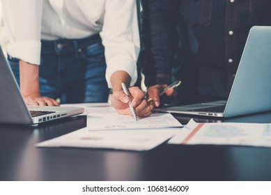 Young business team  meetings concept. A group of young people meeting working with new startup project and  brainstorming analyze plans. Notebook on wood table