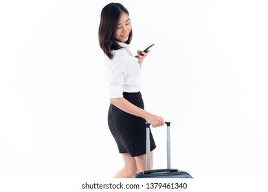 Young business Thai woman use smartphone to check in flight during walking with luggage on white background.