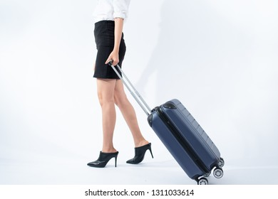 Young business Thai woman walk with a luggage on white background. Business travel concept.