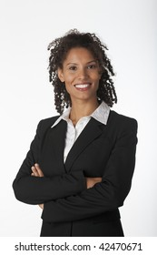 Young business woman with arms crossed. Vertically framed shot.