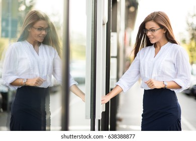 Young business woman at the ATM.