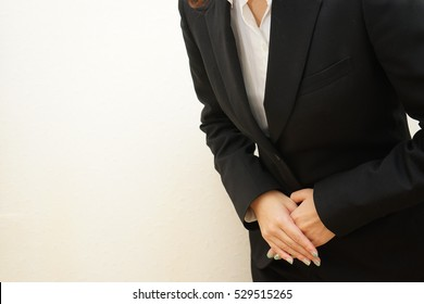 Young business woman bowing at office