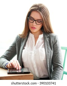 Young business woman busy working in office on white