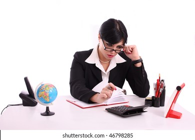 Young business woman calculated at office sitting at desk