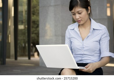 Young Business Woman catching up on some work, surfing the web