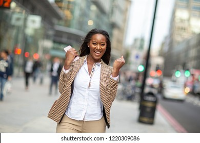 young business woman celebrating an achievement