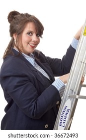 Young business woman climbing a ladder; business metaphor for climbing the business ladder; isolated on a white background.