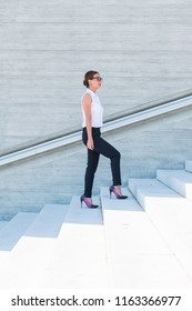 young business woman climbs the stairs