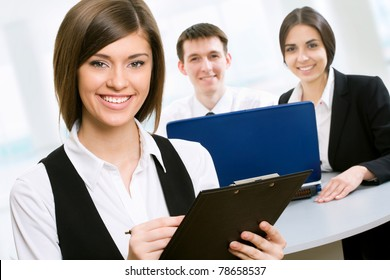 Young business woman with colleagues