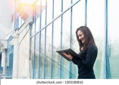 Young business woman controlling bussines from outside. Internet business management concept.