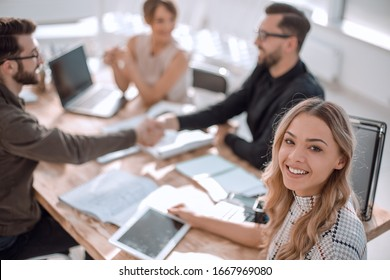 young business woman with a digital tablet at a business meeting