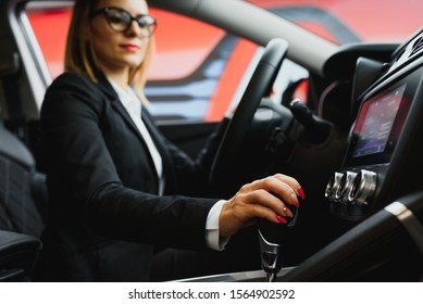 Young business woman driving in her car to work. Successful business concept. business woman driving
