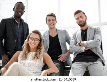 young business woman and employees in the workplace