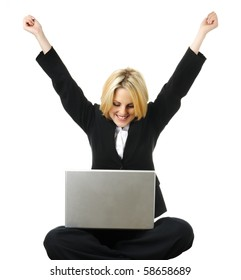 Young business woman is excited after completing work