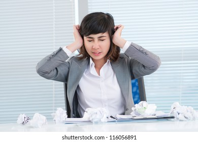 Young business woman experiencing nervous breakdown