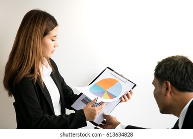 young business woman explain her data to audiance