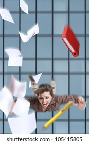 Young business woman falling from the building with her documents