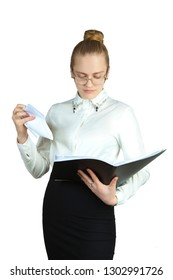 Young business woman with a folder, view report, on a white background. Studio photography.