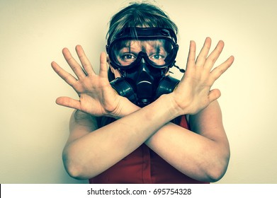 Young business woman with gas mask is showing negative gesture - retro style