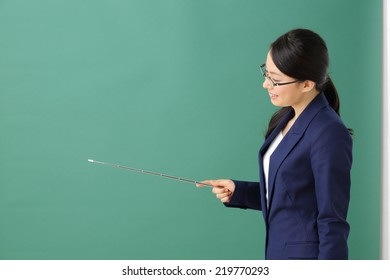 young business woman with glasses against green background