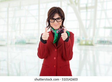 young business woman going thumbs up, at the office