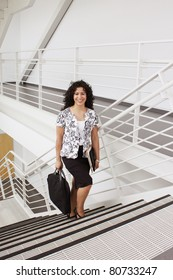 Young business woman going upstairs