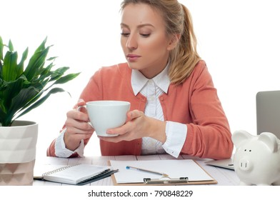 Young business woman having a coffee break. Young woman holding cup of coffee