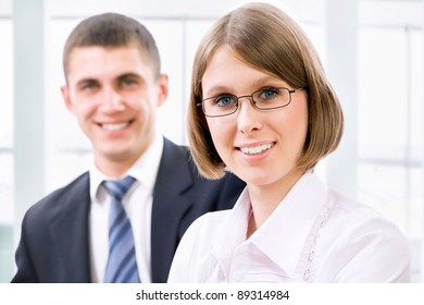 Young business woman with her colleague