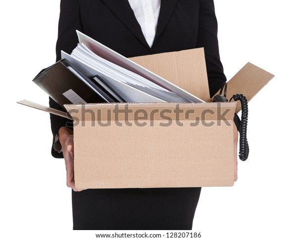 Young Business Woman Holding A Box Of Documents. Isolated On White