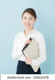 Young business woman holding a file