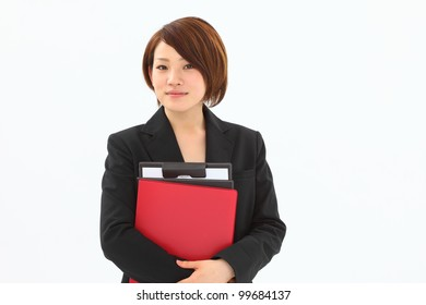 Young business woman holding a file, isolated on white background