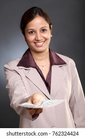 Young business woman holding five hundred rupee notes
